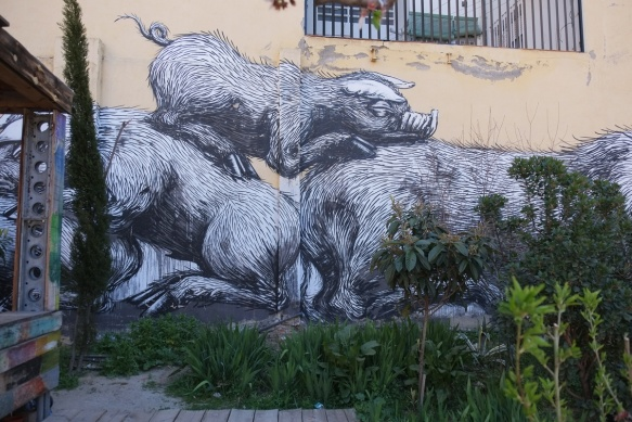 back part of a large mural by ROA, pigs,
