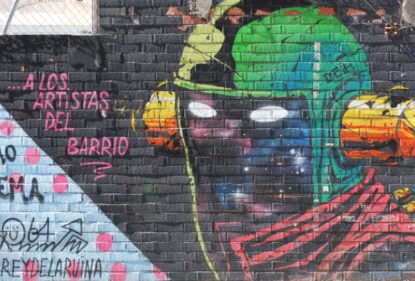 mural of a spaceman's head in a helmet