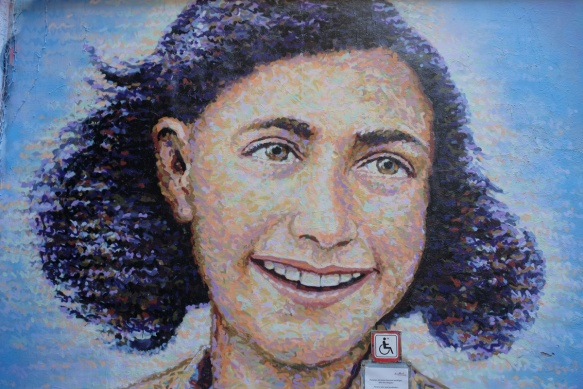 large mural of ann frank, head