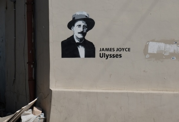 grey tones, black and white portrait of James Joyce who wrote Ulysses