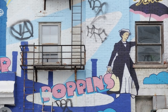 Mary Poppins mural by Antoine Tavaglione aka TAVA in Montreal at corner of Blvd St Laurent and rue Sherbrooke