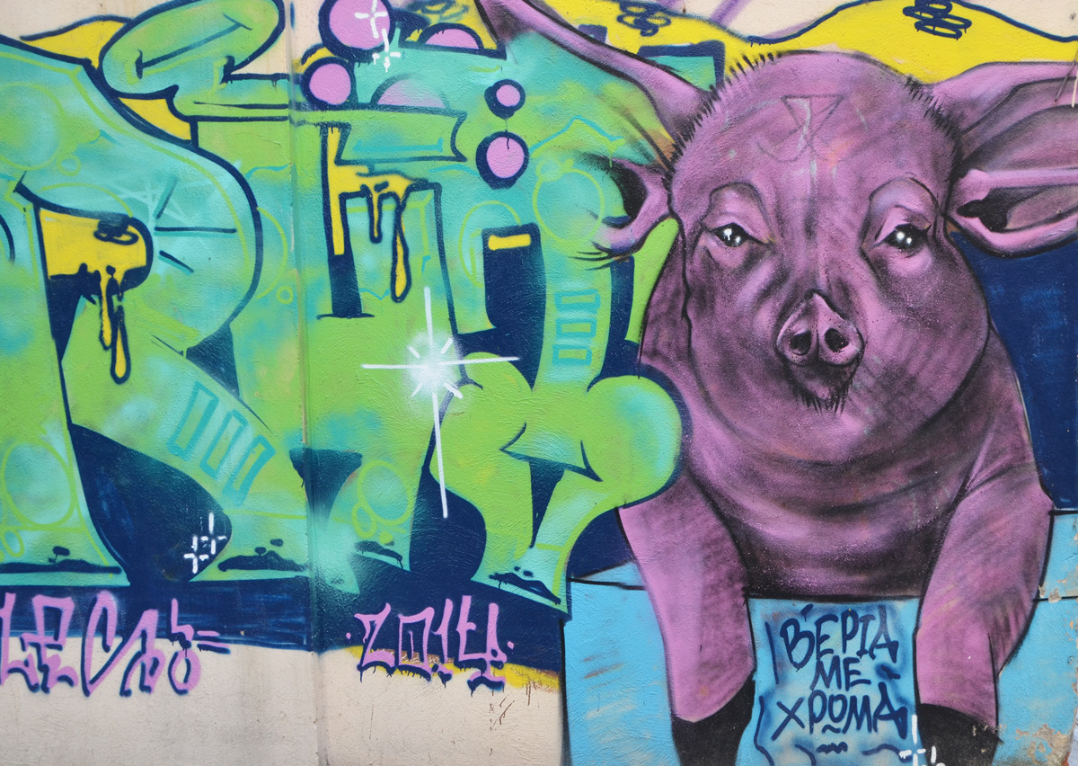 Mural on a wall that includes a realistic looking purple pig. Also words (signature?) Bepia Me Xdona
