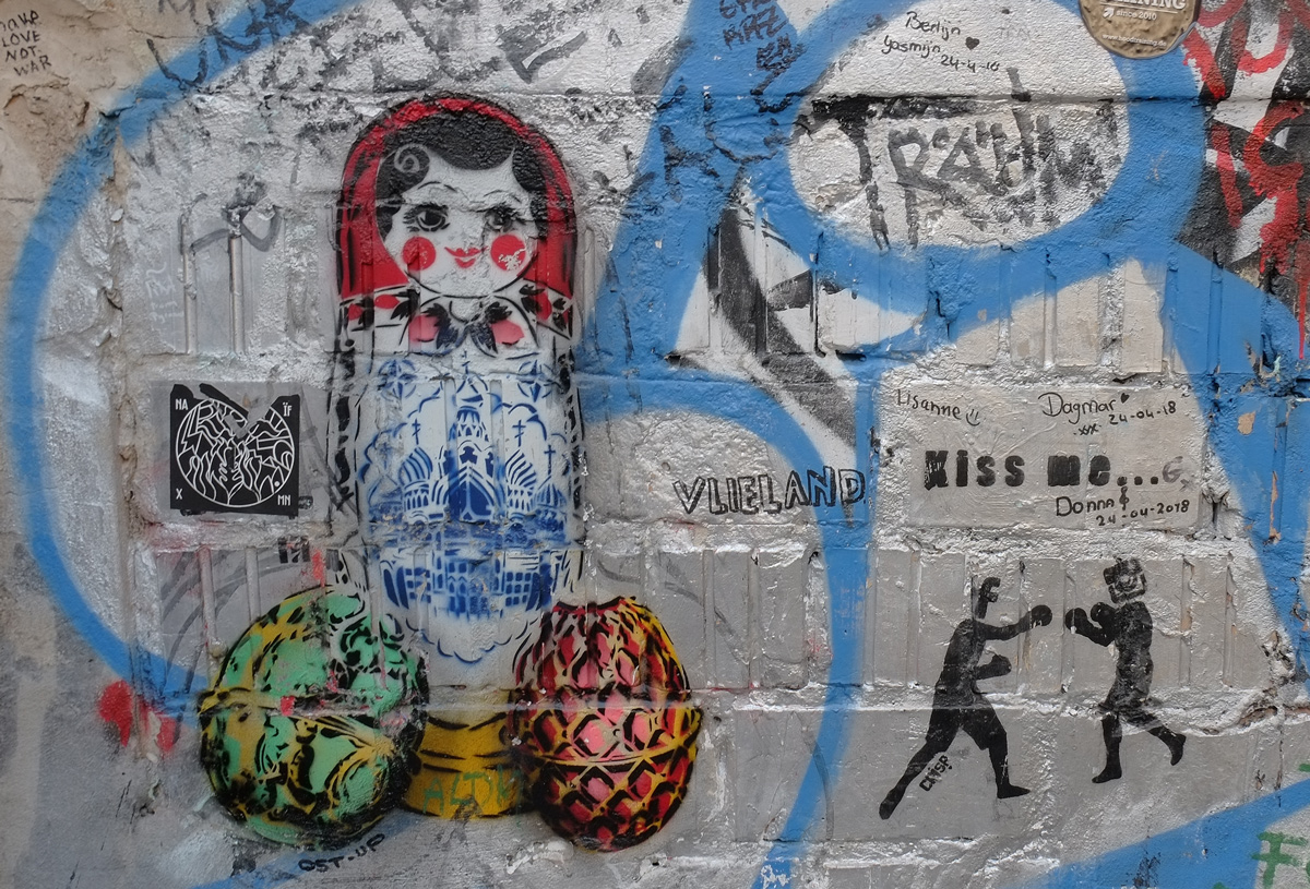 stencil of Russian babushka doll with two fabrege eggs beside it.