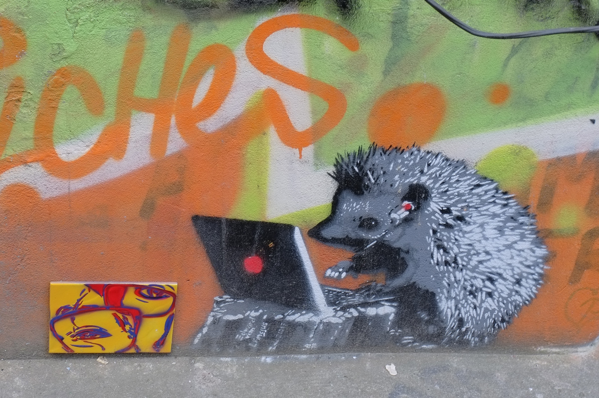 small stencil of a hedgehog with an open laptop