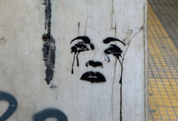 black stencil of a woman's face, just the features, she is crying and black tears are running down her face