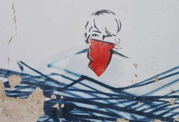 line drawing, in black, stencil, woman's head with face partially obscured by a red bandana over her mouth and nose