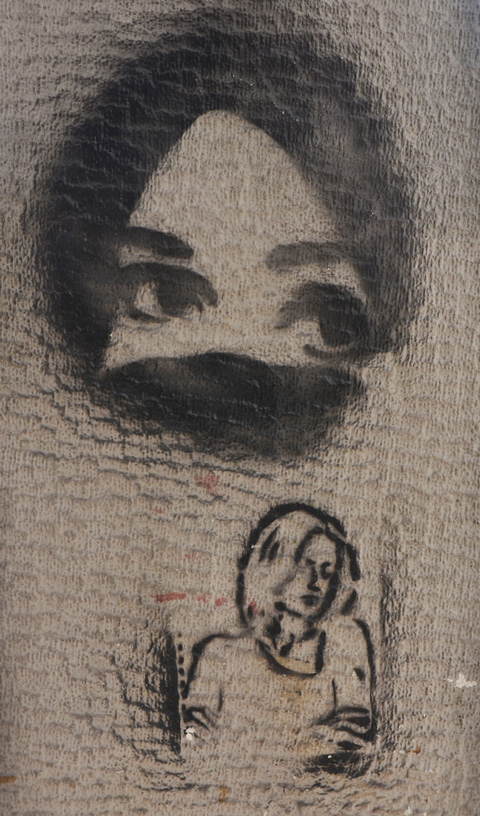 two stencils of women, the top has covering over mouth and nose, the other is a line drawing of a woman's head and shoulders in profile