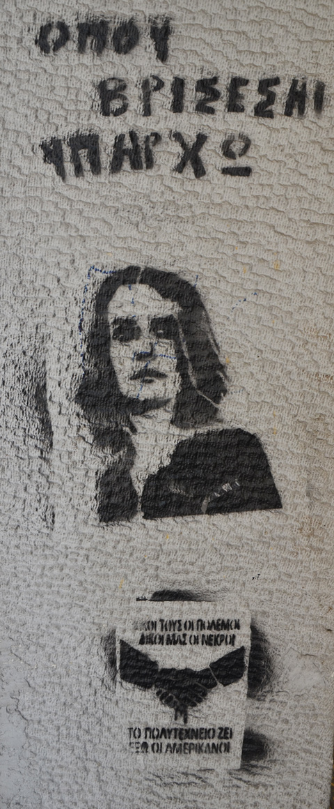 black stencil of a woman on a concrete pole