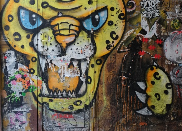 street art, yellow leopard with black spots and blue eyes, mouth open and teeth showing, paw, clown pasteup with red nose