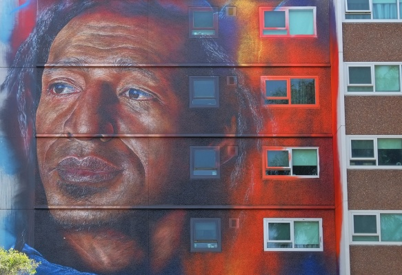 a black man's face in an adnate mural