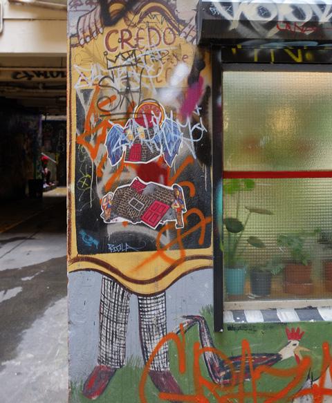 street art beside a window