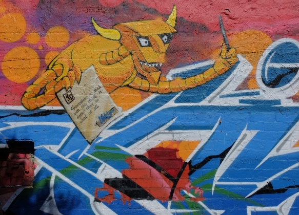 futurama devil in a mural, yellow colour, blue text graffiti, devil is holding a hand written paper that says sometimes a deal with the devil is better than no deal at all