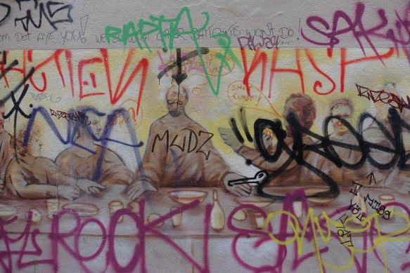 once it was a sepia toned painting of the last supper (religious) but it has had a lot of graffiti written on top of it