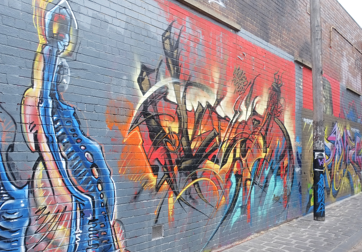 walls along side of artist Lane, mural by heesco is in the center