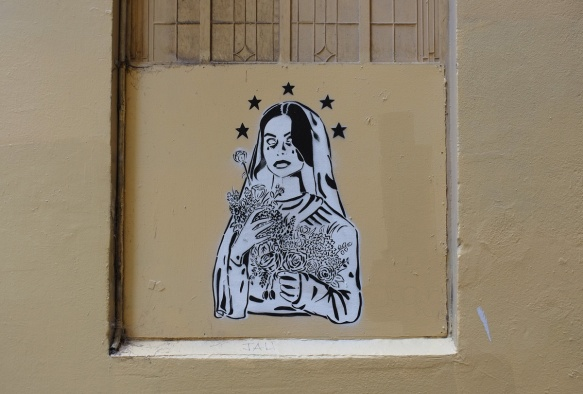 black and white pasteup of a bride in veil, with 5 black stars encircling her head, holding a large bouquet of flowers