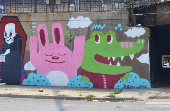 party animals mural by Blake Jones of a large pink rabbit and a green crocodile