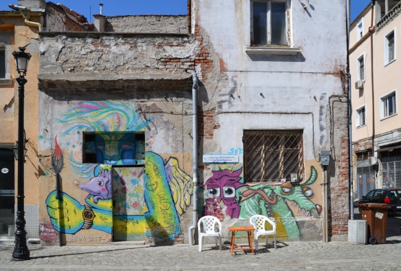 murals by stern on the side of an old building in Plovdiv