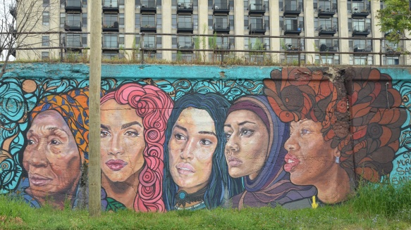 part of a mural by Sam Kirk and Sandra Antongiorgi of five large women's heads
