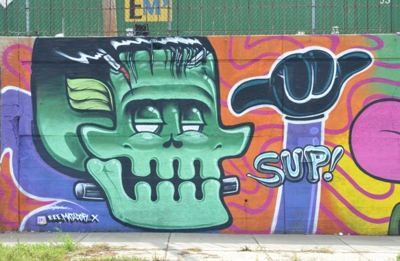 a large green skull in a mural