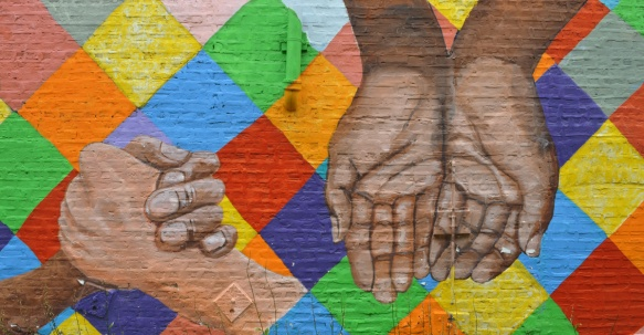 hands in a mural called hands in unity