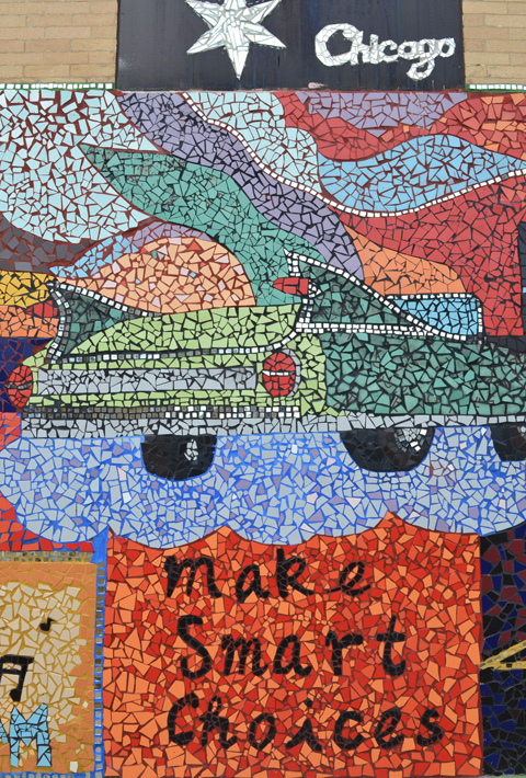 part of a mosaic mural, J DEF peace project, back of a car, with words make smart choices