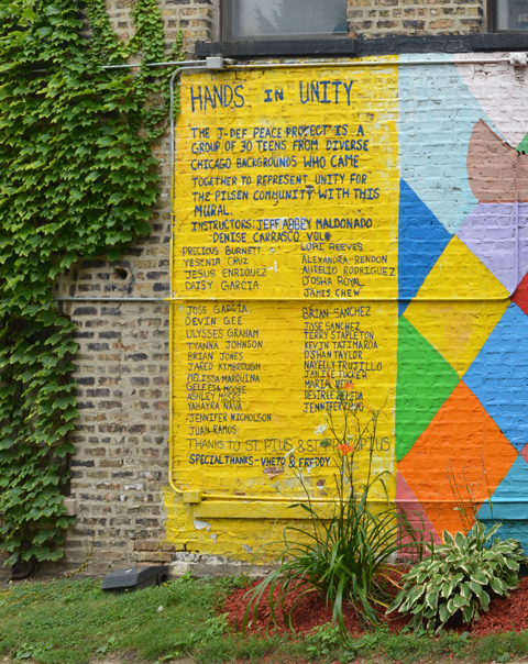 on a yellow background, a list of 30 names of the young people who helped to create a mural on a brick wall on the exterior of St. Pius church