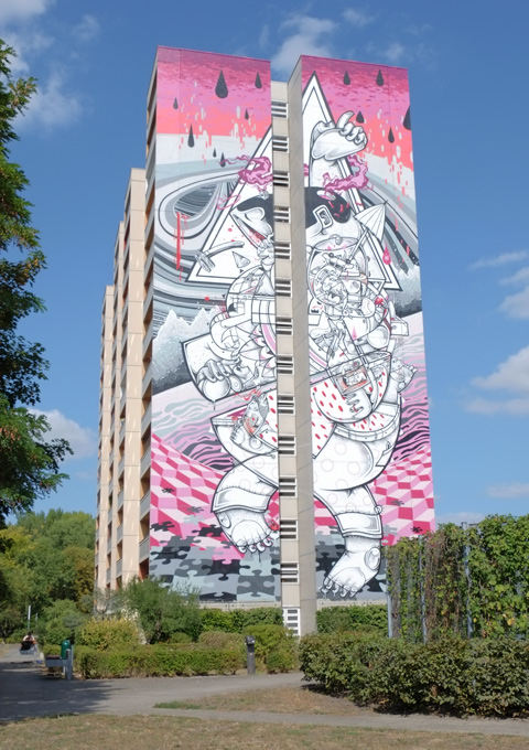 a mural by Spanish brothers How and Nosm, detailed picture of many objects, watermelon on the top and puzzle pieces on the bottom, Urban Nation Tegel Art Park, large mural on side of 13 storey building,