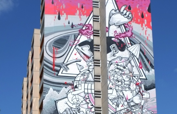 close up of top of mural by How and Nosm, watermelon dripping, Urban Nation Tegel Art Park, large mural on side of 13 storey building,