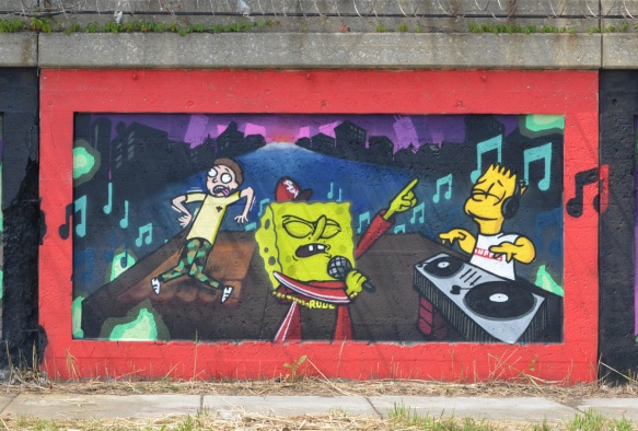 mural on South Wood street in pilsen illinois, a dance scene with an angry sponge bob square pants singing while Bart Simpson is the D J with two turn tables, a man is trying to dance