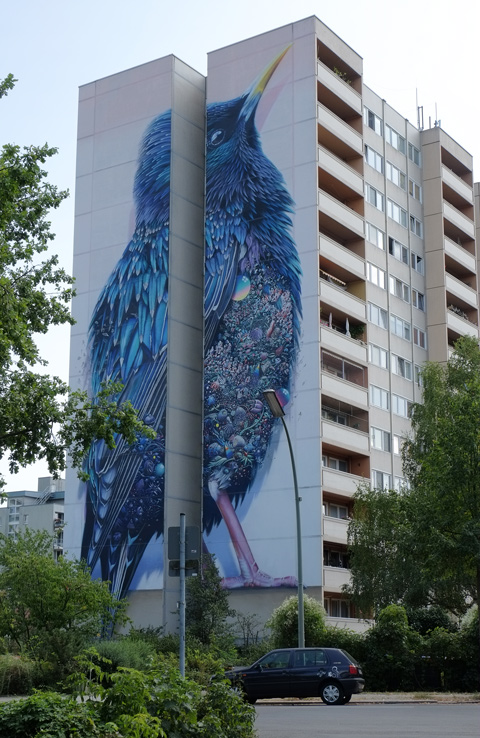 ,arge, bright blue bird, Urban Nation Tegel Art Park, large mural on side of 13 storey building,