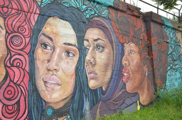 mural by Sam Kirk and Sandra Antongiorgi of three large women's heads