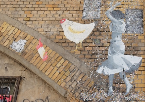 street art project, It's time to dance, by French street artist Sobr or Sobreon a brick arch, a paste up in black white, life size picture of people dancing,