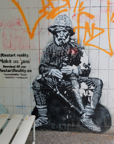 in shades of grey, street art of a person - a soldier sitting down, helmet on and gun in lap by Edward von Longus
