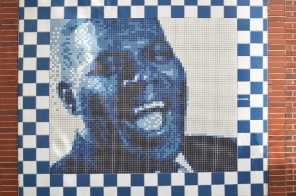 mural of a black man singer made in tiles in blacks and white with shades of blue