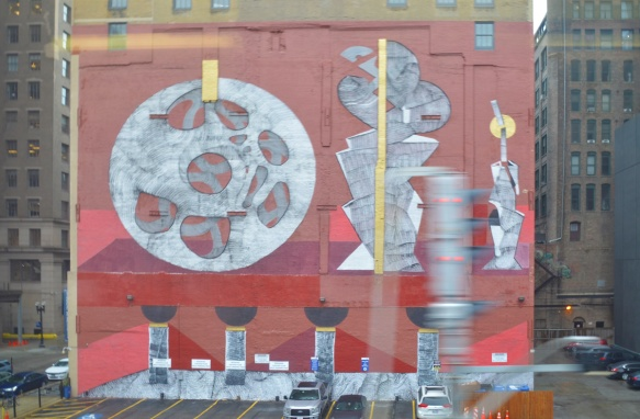 seen through the window of a train, a large mural in Chicago