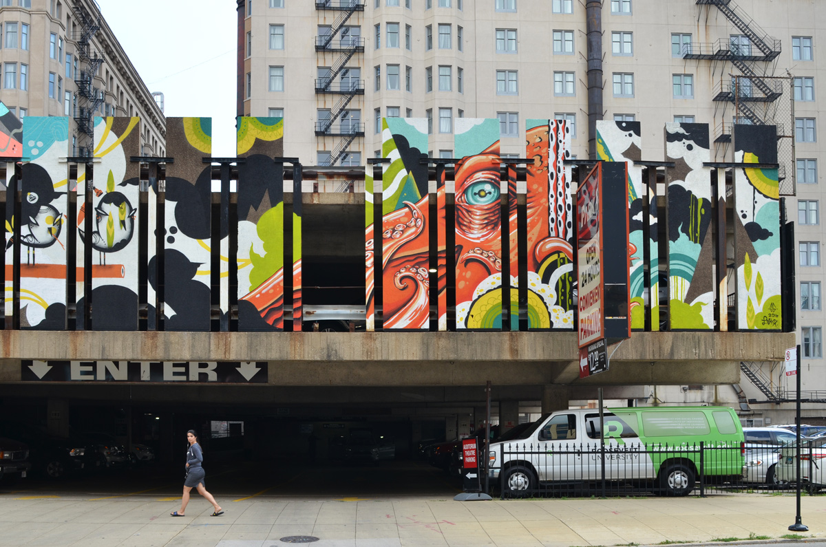 walls of an elevated parking structure painted in an octopus mural