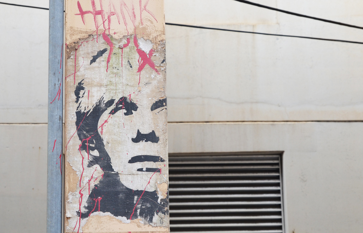 paste up of Andy Warhol on a post