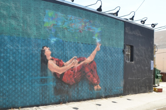 mural of a person suspended in midair