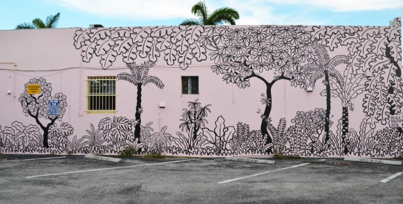 mural by Nicole Salcedo, a pale pink wall with black outline drawing of trees and plants
