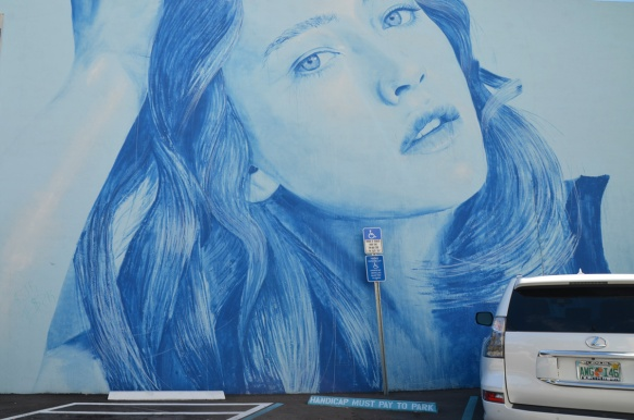rone mural of a woman's head in blue tones