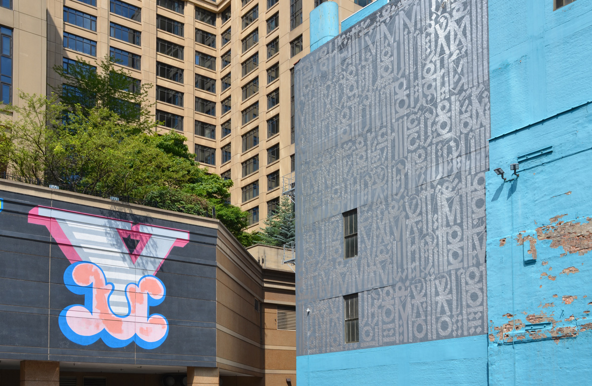 part of two murals, the letter Y and one in silver and grey