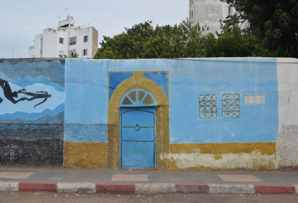 part of a series of murals on a Casablanca walla blue door with gold trim