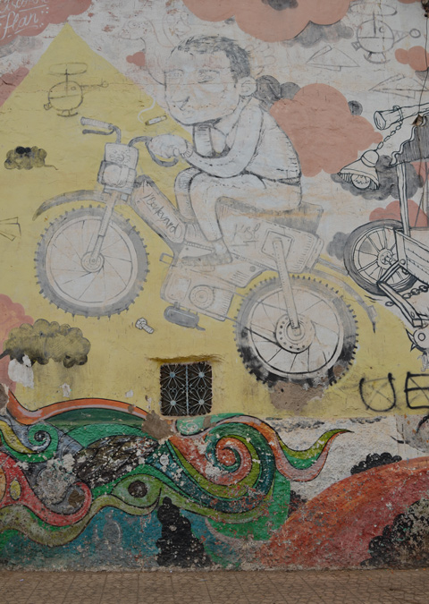 on a yellow background, mural, a boy riding a motorbike, by flan,