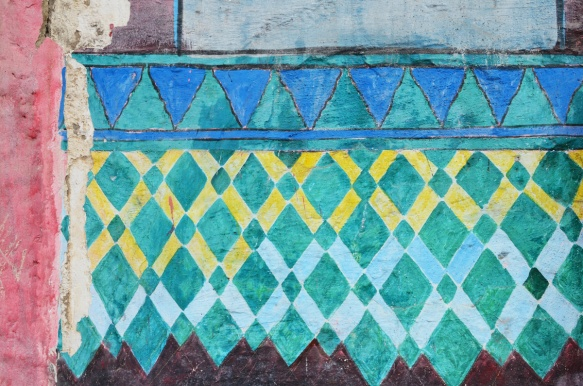 part of a series of murals on a Casablanca wall, tile patterns, triangles and diamond shapes in yellow, green, and blue