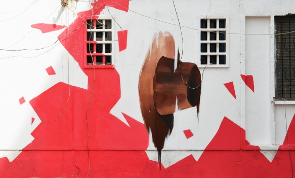 part of a mural by oldr, a brown hat falling