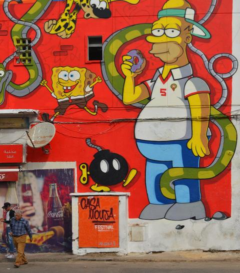 a mural of cartoon characters by moka, Homer Simpson and Spongebob Squarepants