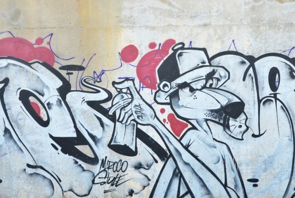 a dog-like creature wearing a baseball cap is spray painting a tag on a wall, mural
