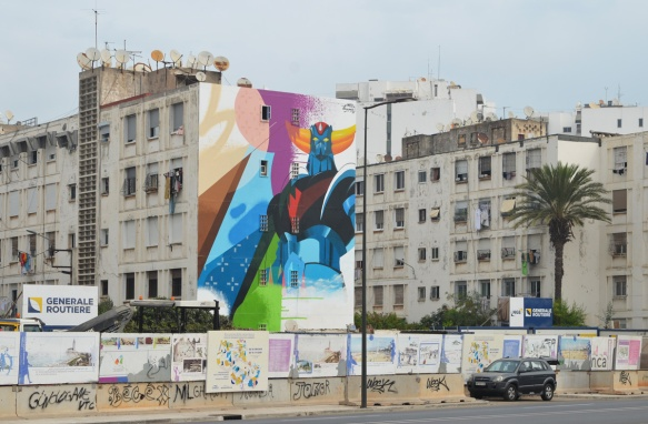 in a residential area of apartment buildings, a large mural by med