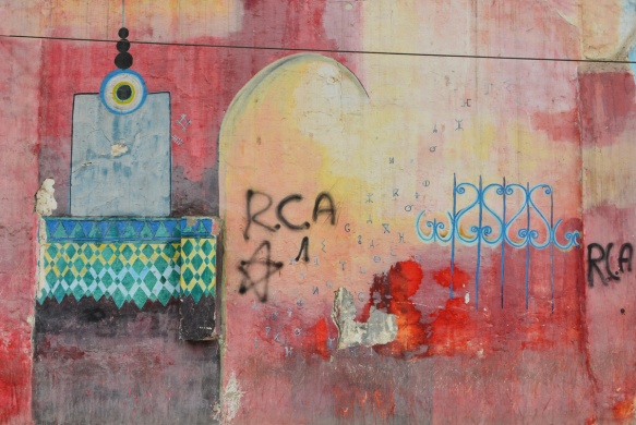 mosque with red sky, some tagging by RCA, mural