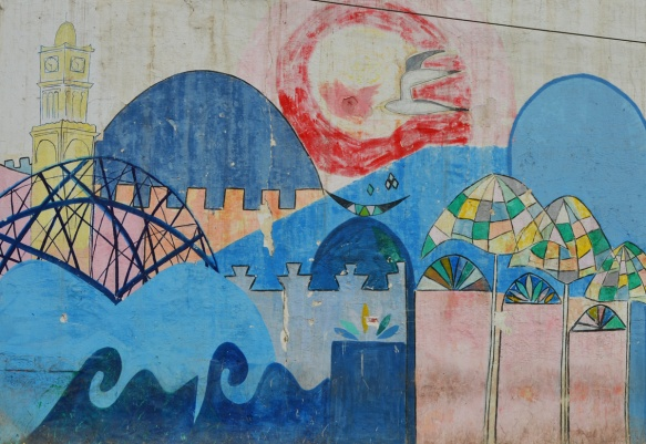 red sun, blue waves, hussan 2 mosque, brown wall, umbrellas, casablanca scene painted in a mural
